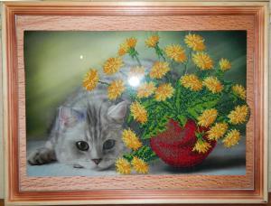 Котенок в одуванчиках